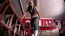 Blonde Mistress in boots with high heels likes to step all over her submissive partner