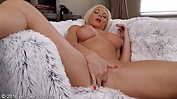 Hot blonde with big boobs, Carolina Carla is squeezing her big tits and rubbing her pussy