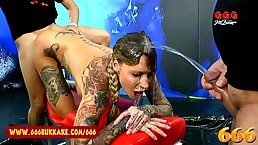 Busty pornstar with many tattoos, Calisi is facesitting a guy on the stage, before getting fucked